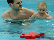 baby swimming with float